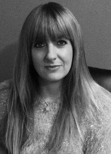Black and   white photo of author Kendra Leigh